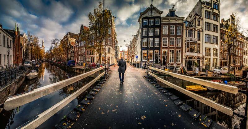 Amsterdam local on canal bridge