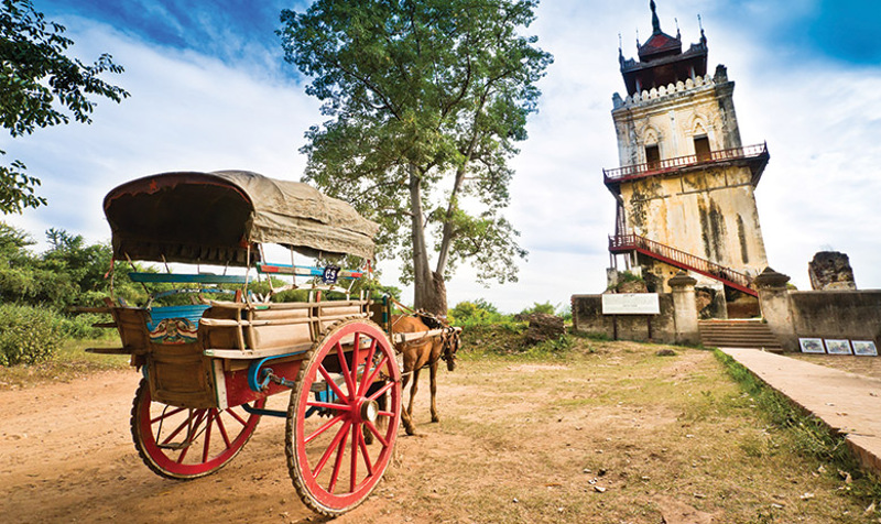 Horse drawn cart and historical tower Myanmar