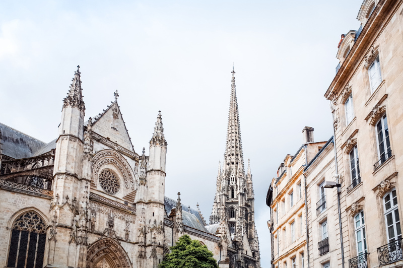 Ornate cathedral spire against blue sky, Bordeaux