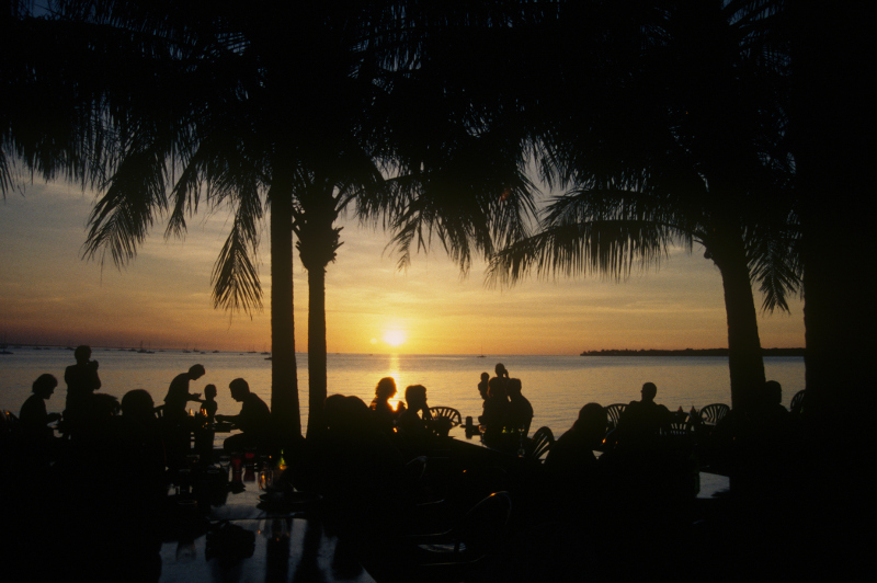 People enjoy a sunset at one of many Darwin Harbour watering holes