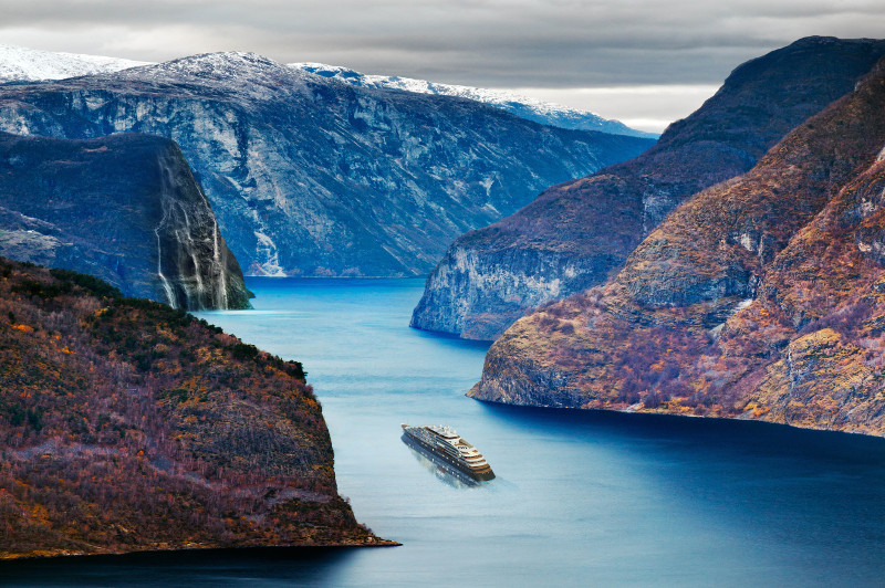 Scenic Eclipse super yacht sails through beautiful fjord