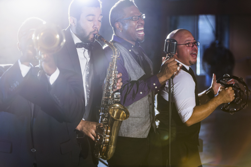 Four musicians playing jazz instruments