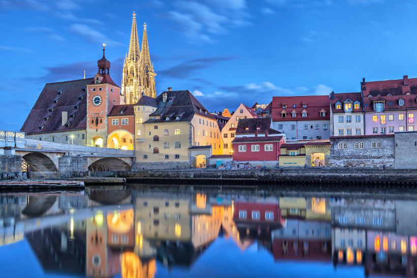 Travel Associates german town on river at nighttime