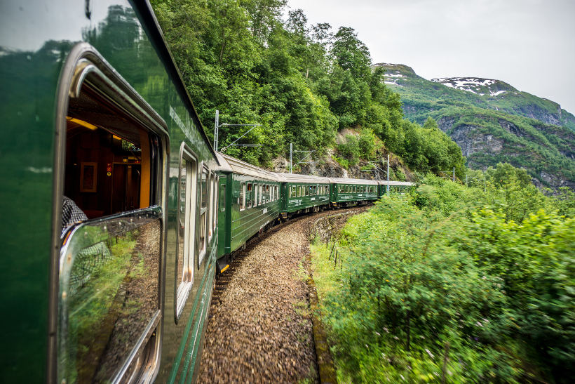 Travel Associates flam railway in lush mountains