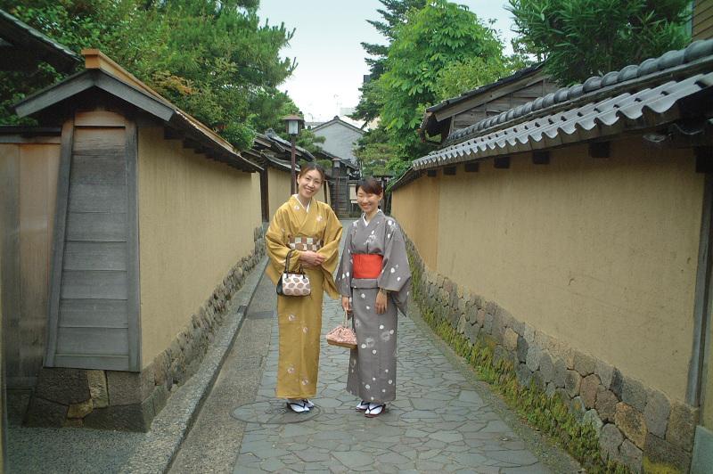 Young geisha walk along the streets of Higashi Chaya Geisha district