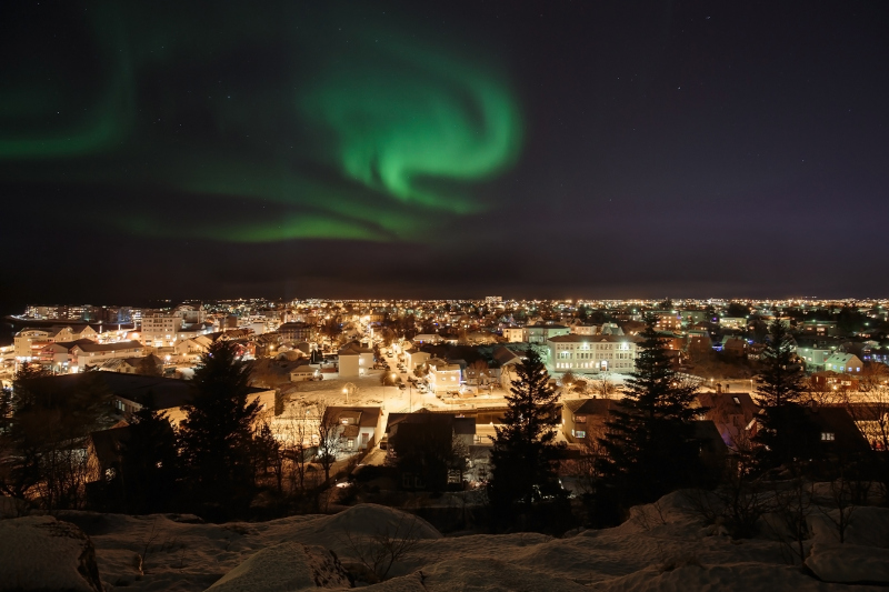 Northern lights over city in Iceland