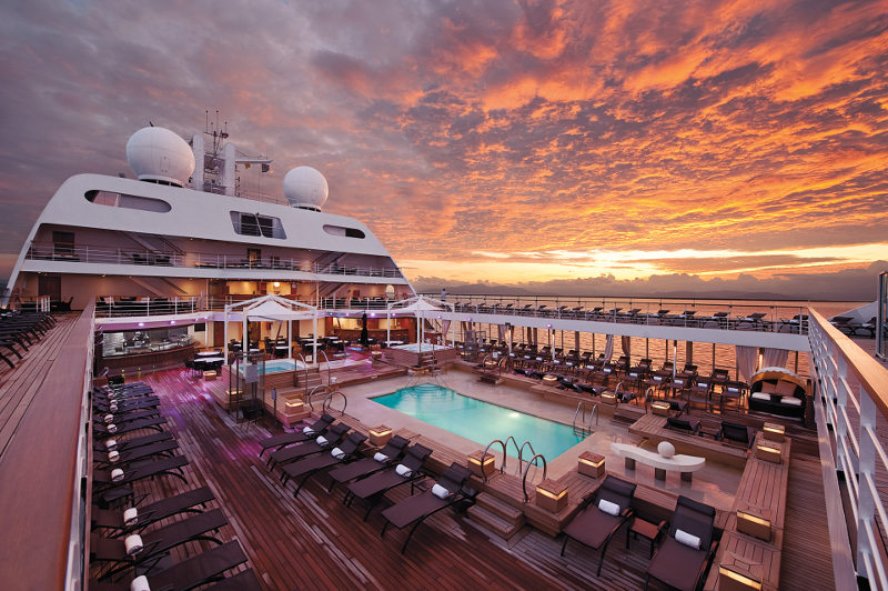 Luxury cruise ship deck with pool and deck chairs