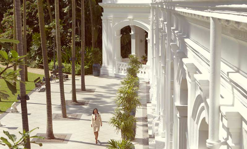 Sweeping white columns of Raffles Hotel Singapore