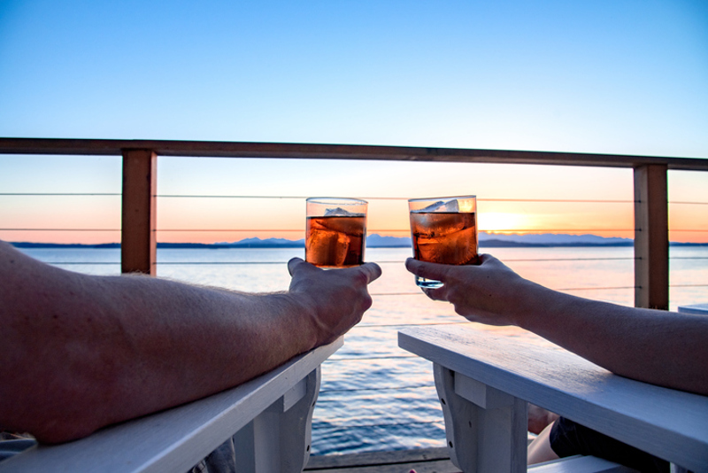 Couple drinking rum in sunset