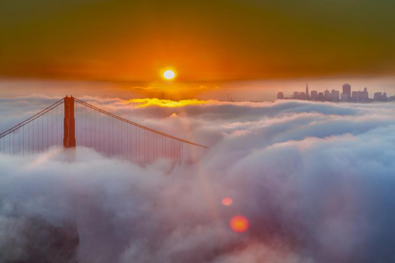 San Francisco skyline and Golden Gate Bridge at sunrise