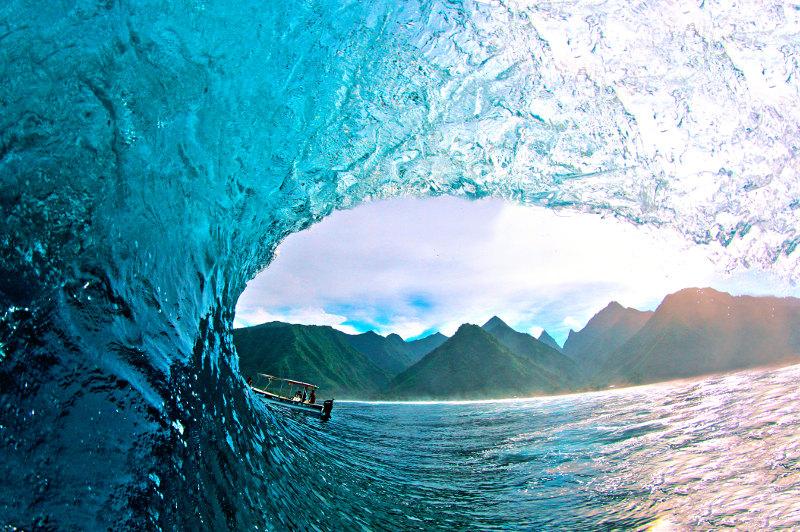 Perfect barrel wave breaks at Teahupoo Beach