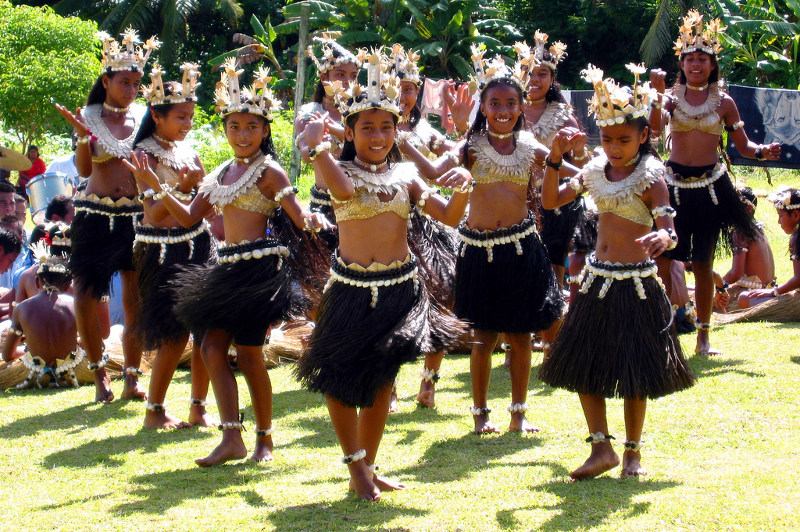 Rabi schoolchildren put on a traditional dance performance