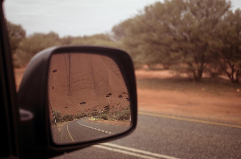 Uluru in car review mirror