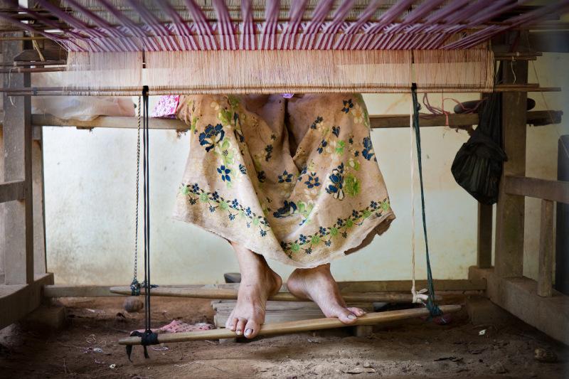 Lady's feet at weaving loom, Cambodia