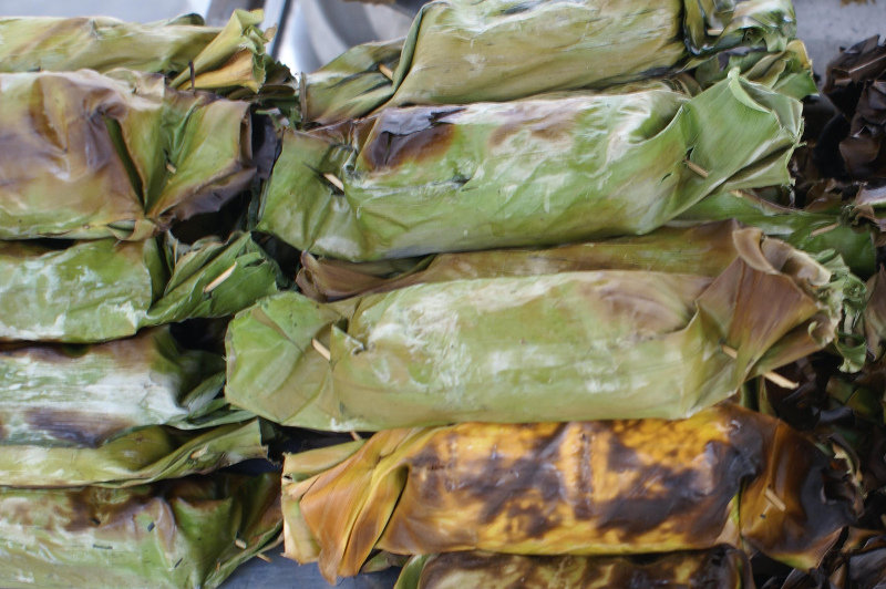 Leaf wrapped parcels of food cooked in a Tahitian ground oven