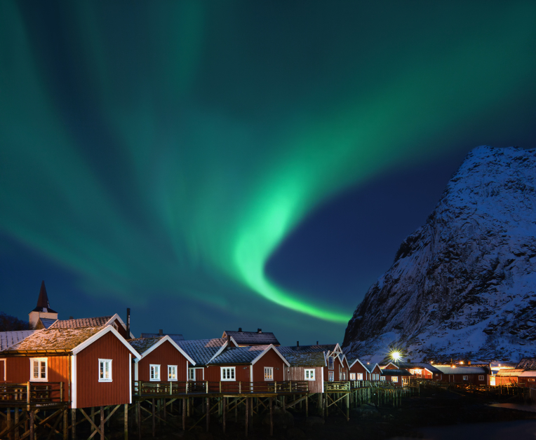 This image: The Aurora Borealis over the fishing village of Reine, Norway.