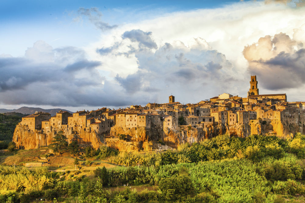 This image: Medieval town of Pitigliano at sunset, Tuscany.