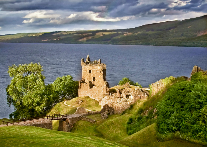 Urquhart Castle keeps watch over Loch Ness where the illusive water monster is said to live. Image: Getty.