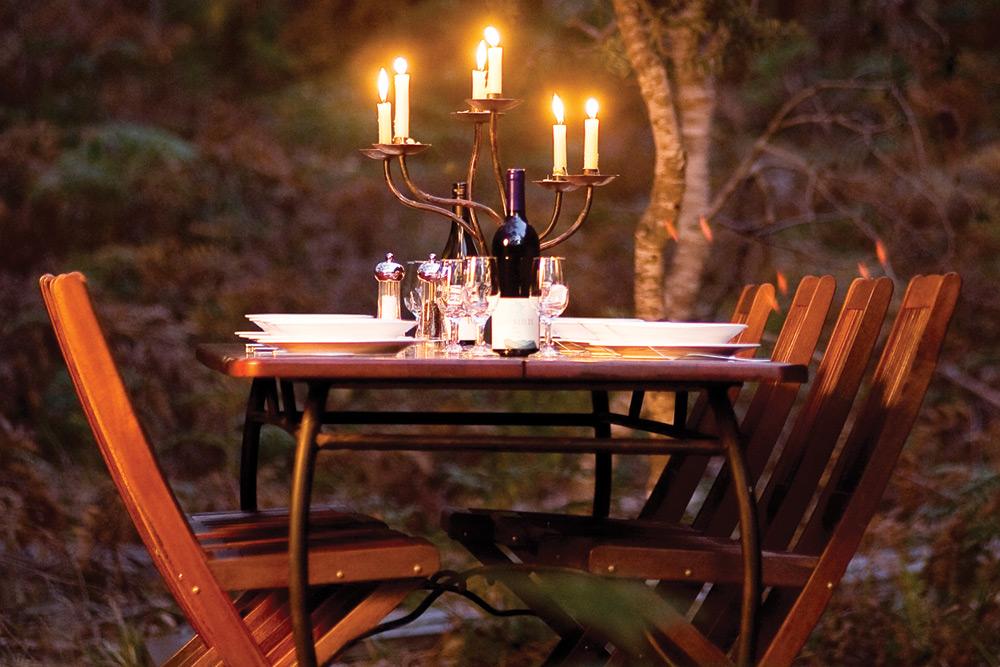 Candlelit dining at Casuarina Beach Camp. Image courtesy of The Maria Island Walk.