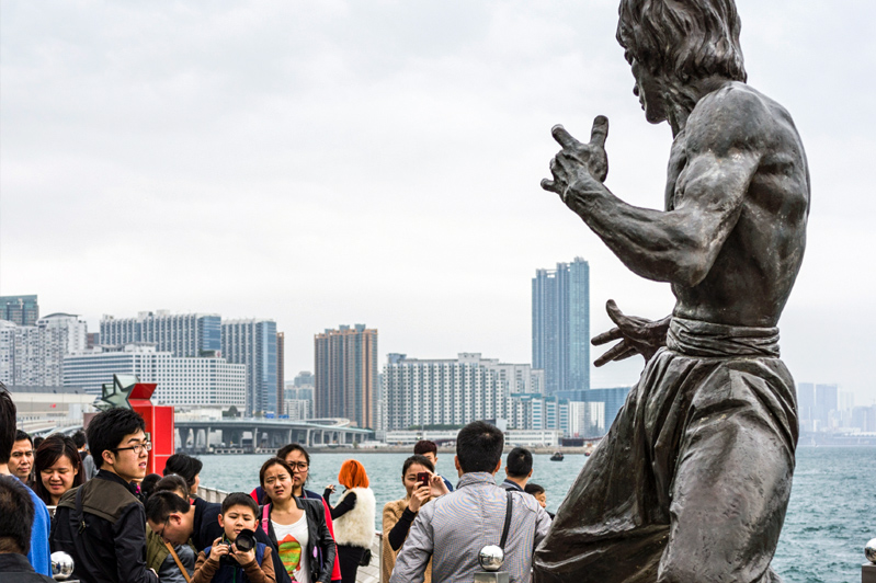Statue of Bruce Lee on the Avenue of Stars, along the Tsim Sha Tsui waterfront. Image: Getty images.