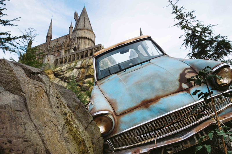 The famous flying Ford Anglia car with Hogwarts Castle in the background. Image: Universal Studios