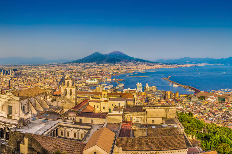 The city of Naples with Mount Vesuvius at sunset. Image: Getty