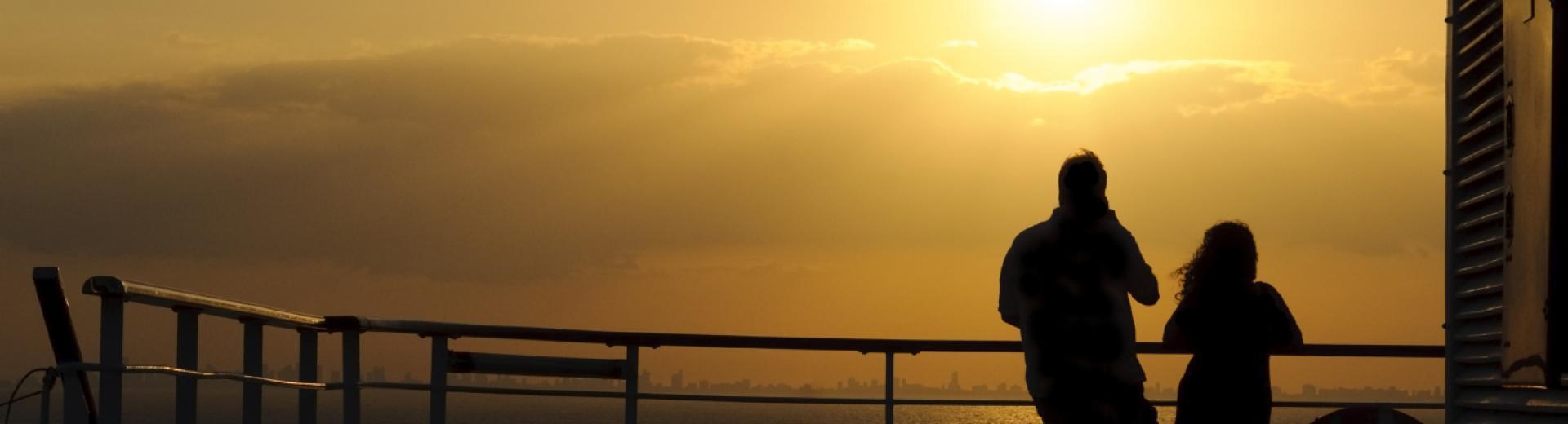 Cruise sunset couple on deck