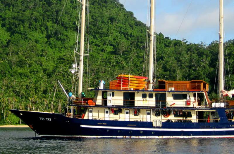 The Tui Tai ship is docked in a scenic, secluded bay