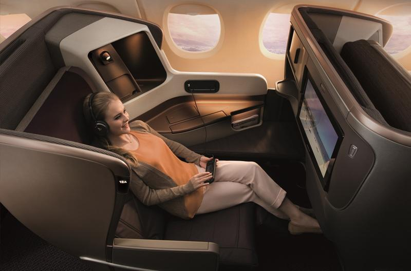 Image of lady enjoying Singapore Airlines Business Class
