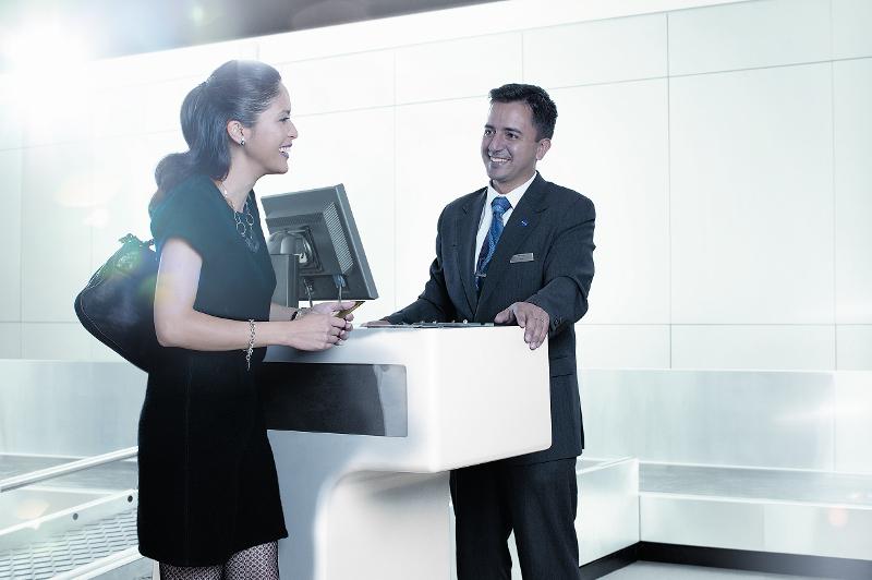 Woman checks in at Qantas counter