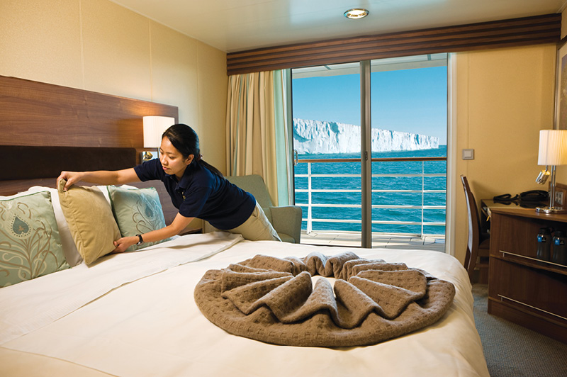 Upper Deck cabin with balcony on the Lindblad Expeditions National Geographic Explorer