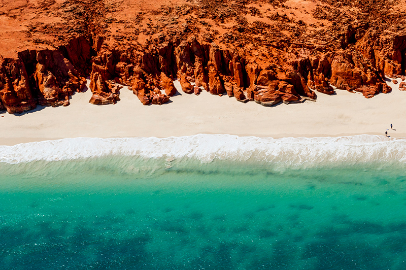 White sands, turquoise ocean and striking red Kooljaman Cliffs at Cape Leveque