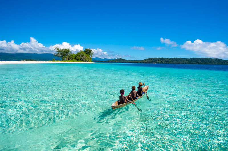 Dive beneath the surface in Solomon Islands Kids paddling along the beautiful islands of Marau Sound