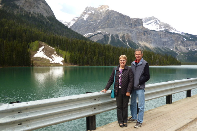 couple infront of lake in the rocky mountains