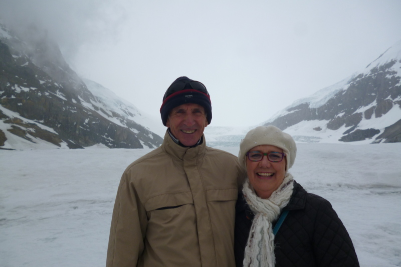 couple on athabasca glacier canada