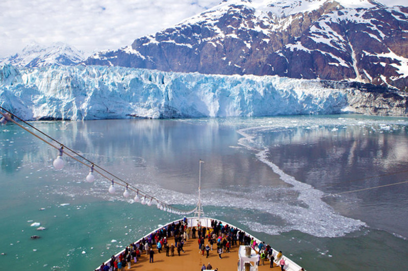 cruise ship in front of glacier alaska