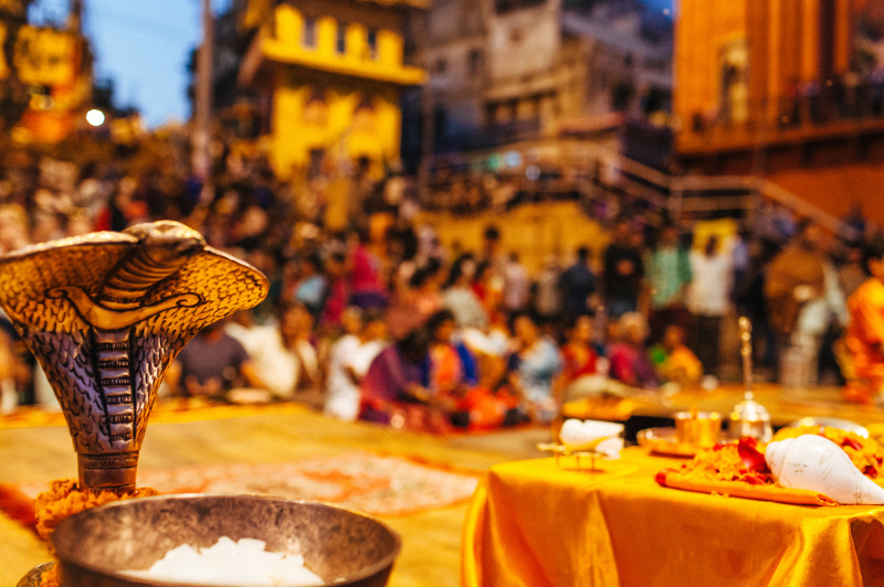 A firelit Aarti evening ceremony