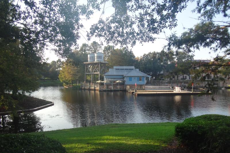 Green riverbank overlooks Disney New Orleans themed hotel