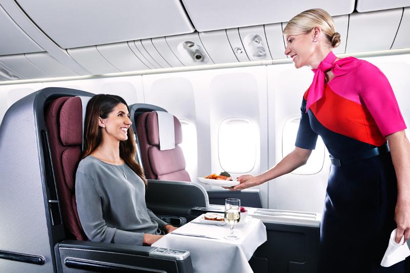 Air hostess hands guest a drink