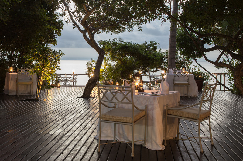 Dining table set up on deck in tropical location