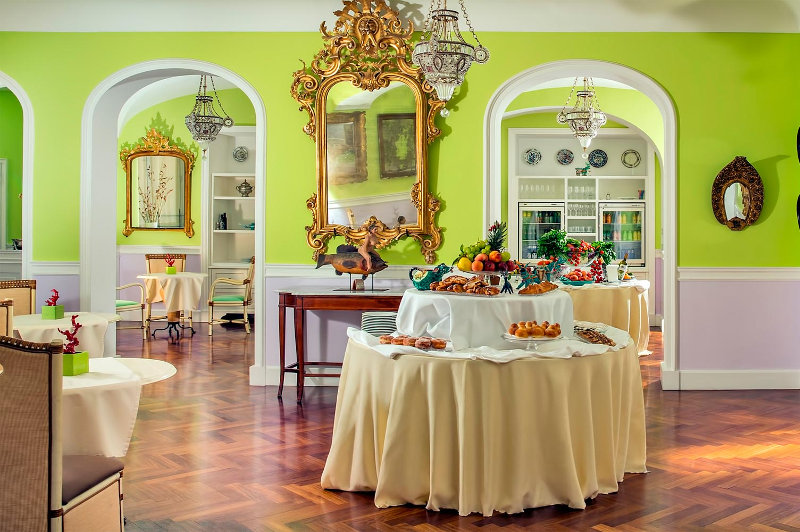 Lime green chic restaurant interior at hotel Bellevue