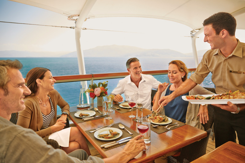 Group dines on board a luxury cruise ship