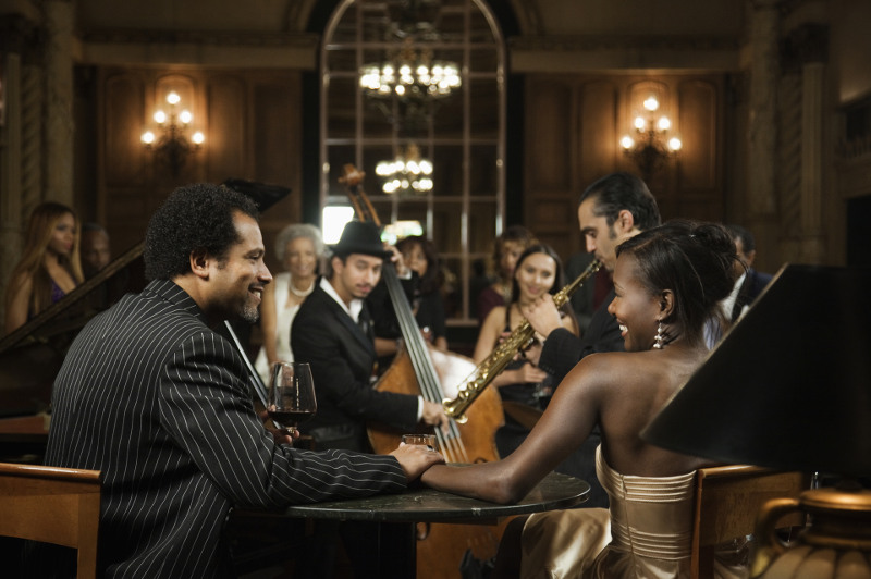 Couple watches live jazz concert in club