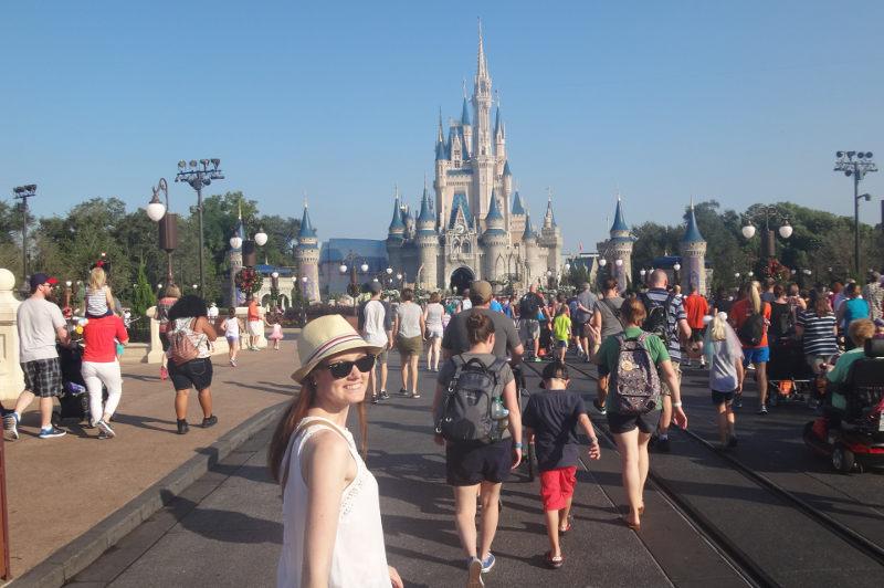 Travel Associate walks toward Disney World's Magic Kingdom
