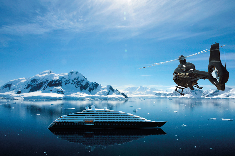 Cruise ship and helicopter in icy ocean location