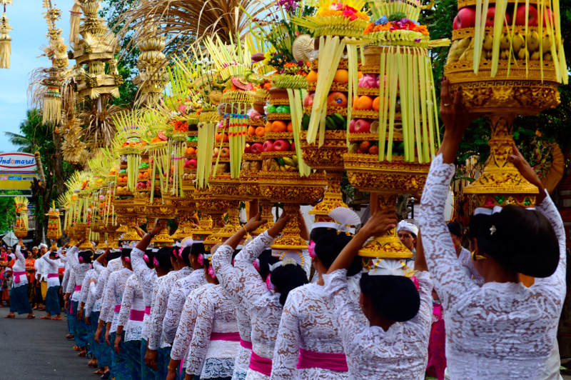 Traditional Balinese procession with fruit baskets carried on heads