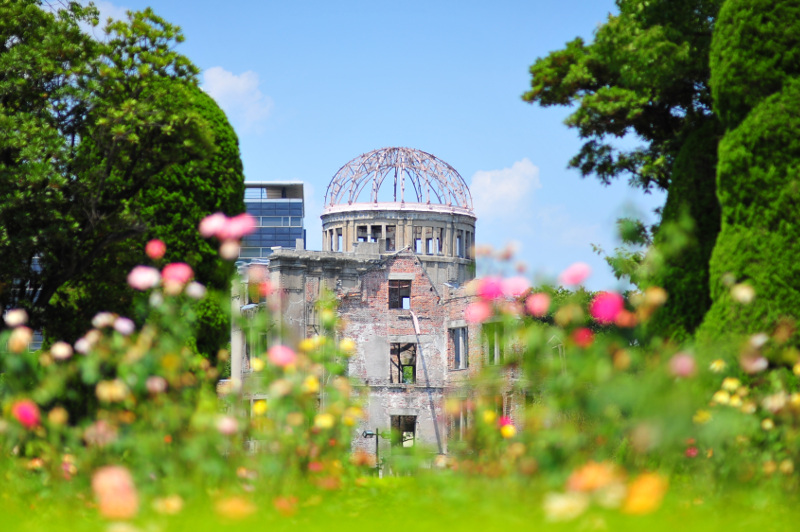 The ruins of the Genbaku Dome in Hiroshima, with flowers in foreground