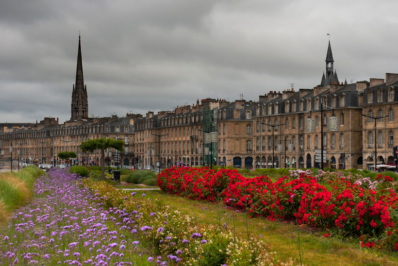 Travel Associates bordeaux houses with flowers in park infront