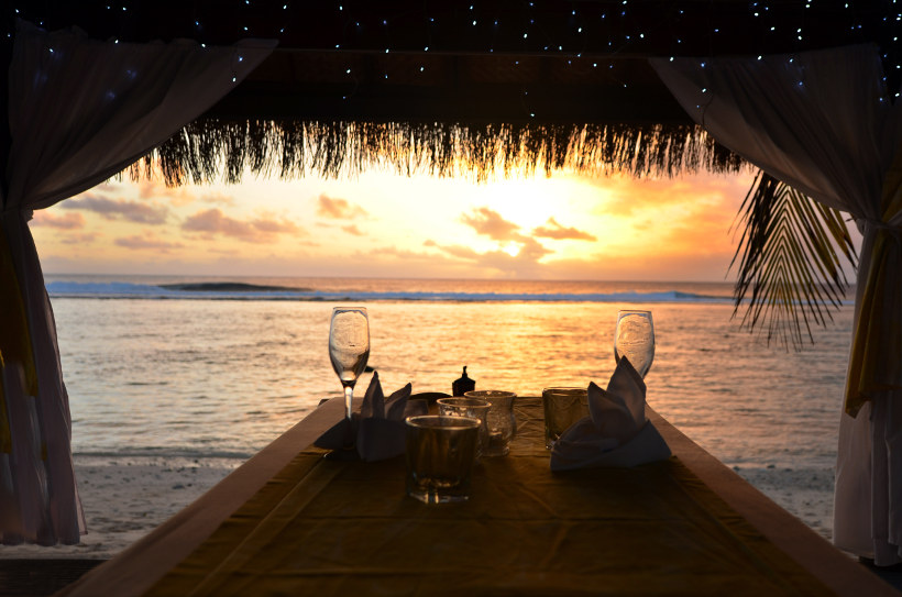 Travel Associates table with wine glasses sunset rarotonga