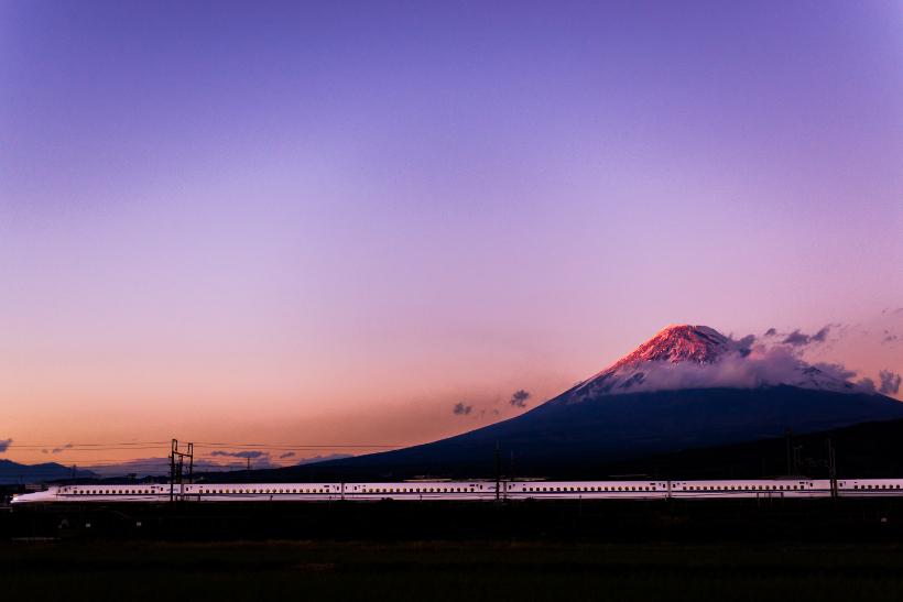 Travel Associates japan rail infront of mount fuji at dusk